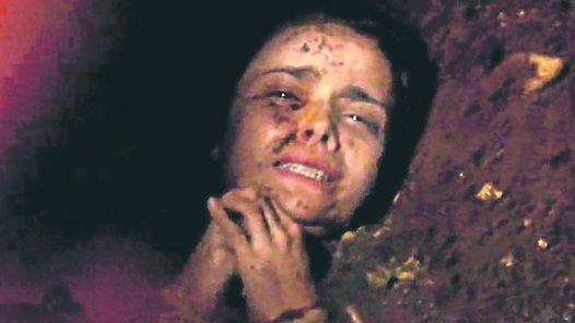 Nina sendo enterrada viva por Caminha.  Foto reprodução.