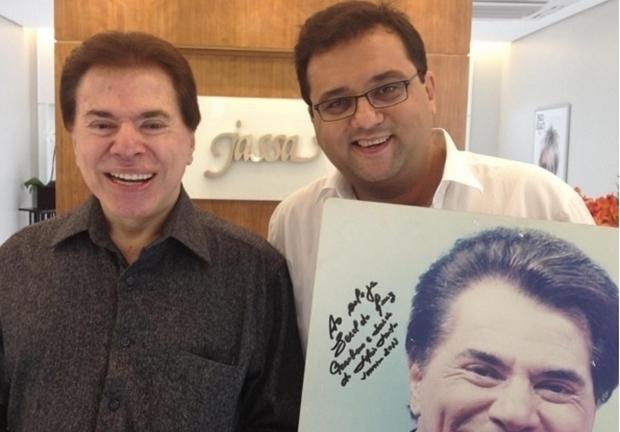Geraldo ao lado de Silvio Santos. (Foto: Reprodução)