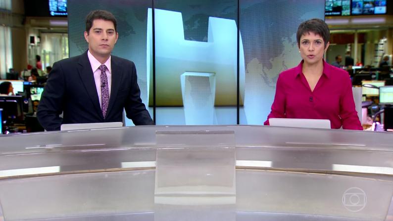 """Evaristo Costa e Sandra Annenberg no """"Jornal Hoje"""" (Foto: Reprodução/Globo)"""