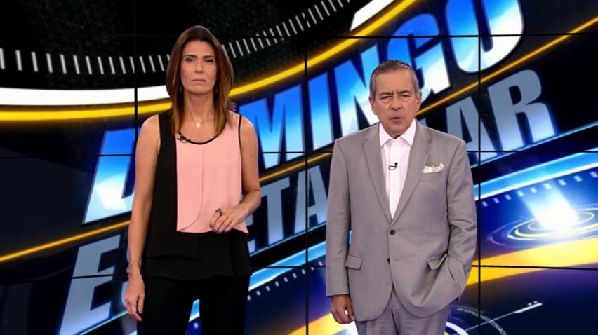 """Janine Borba e Paulo Henrique Amorim no """"Domingo Espetacular"""" (Foto: Reprodução/Record)"""