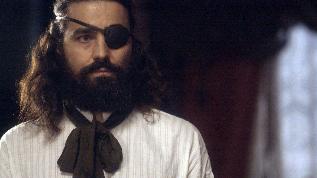 Ferdinando em cena da novela de Novo Mundo com um tapa olho