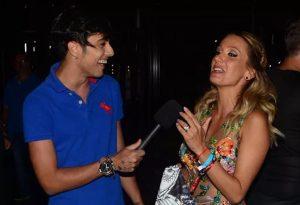 O repórter Gabriel Leão em entrevista com Luisa Mell (Foto: Reprodução)
