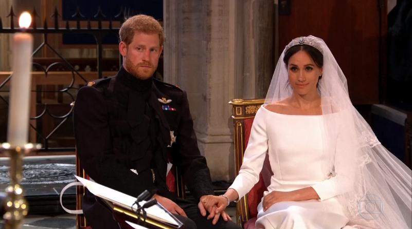 Príncipe Harry e a atriz Meghan Markle durante o casamento (Foto: Reprodução/Globo)