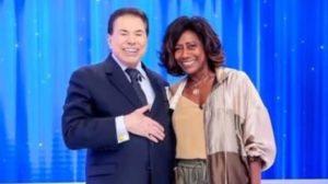 O dono do SBT, Silvio Santos e a apresentadora da Globo, Glória Maria (Foto: Reprodução)