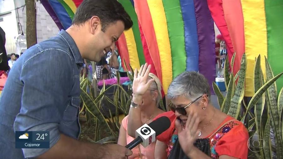 O repórter Marcelo Poli, da Globo, é paquerado na Parada LGBT Imagem: Reprodução/TV Globo