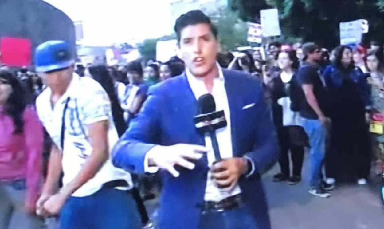 Repórter leva soco durante reportagem ao vivo (Foto: Reprodução)