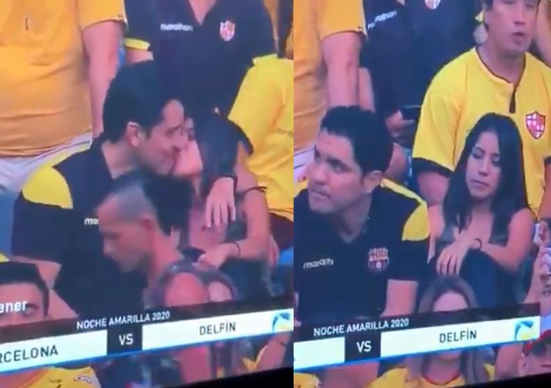 O sujeito se arrependeu de beijar namorada ao perceber que estava sendo filmado em estádio de futebol ao vivo (Foto: Reprodução) homem