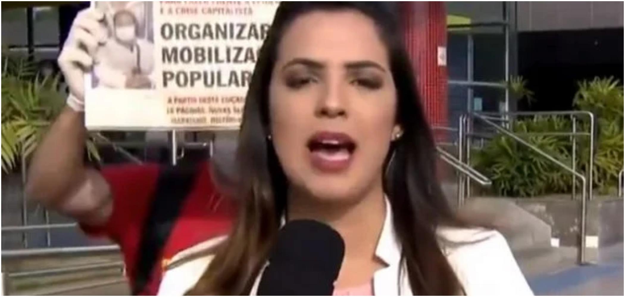 Repórter do SBT foi interrompida ao vivo (Reprodução) globo