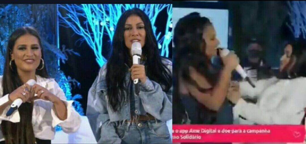 """Blusa de Simone abre durante live e cantora é """"socorrida"""" pela irmã, Simaria. (Foto: Reprodução)"""