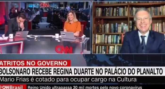 Reinaldo Gottino, Daniela Lima e Fernando Molica caem na risada após entrevista de Mario Frias (Foto: Reprodução/CNN Brasil)