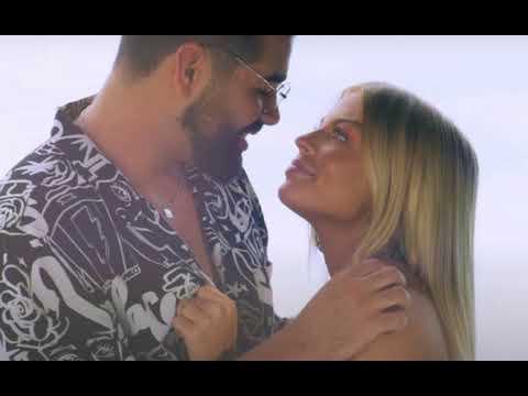 Dilsinho e Luísa Sonza protagonizam cenas românticas durante clipe (Imagem: Reprodução)