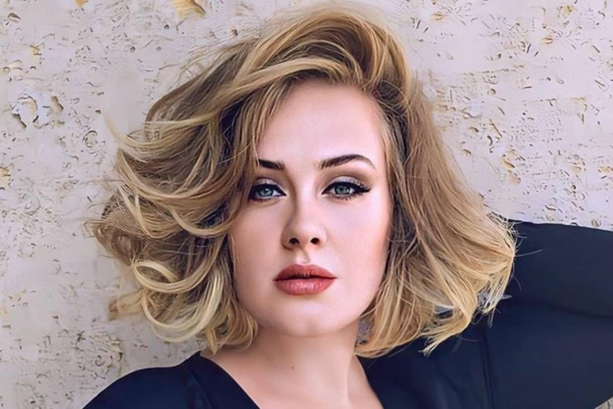 Relação entre Adele e rapper bonitão é apontada pela web (Foto: Reprodução)