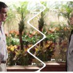 Na imagem há uma separação por curvas entre os personagens René e Griselda da novela Fina Estampa que estão de pé um de frente para o outro se encarando, no fundo há uma paisagem de plantas