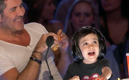 Simon Cowell e o filho Eric (Foto: Reprodução)