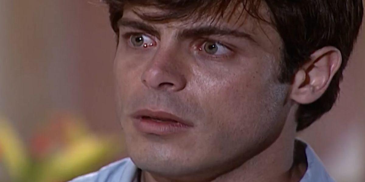 Fred, homem branco, cabelo castanho, com expressão de apreensão na novela Laços de Família