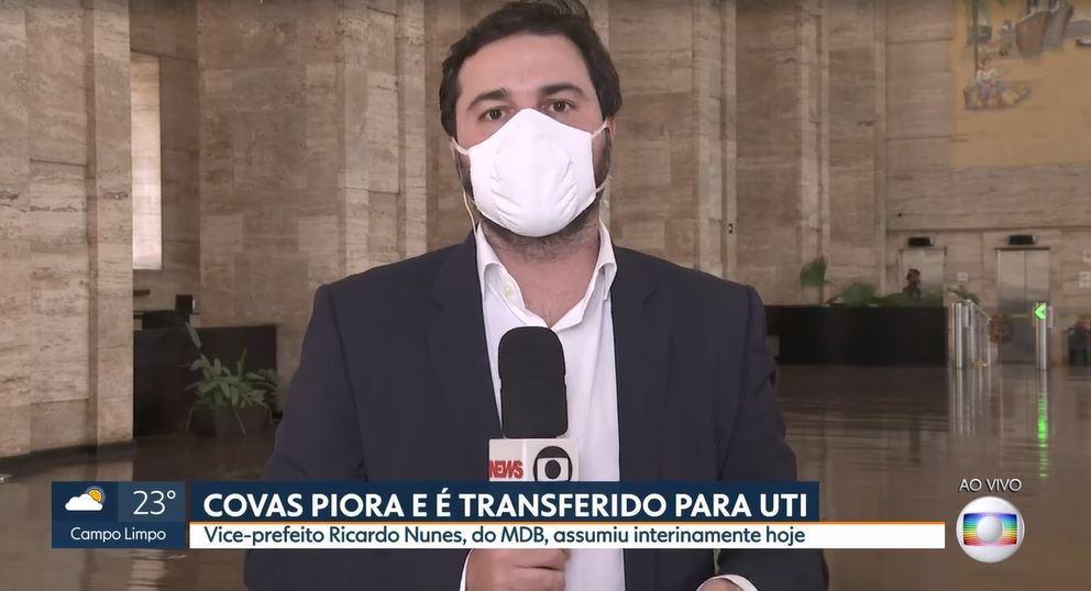 O repórter Filippo Mancuso leu comunicado da prefeitura ao vivo (Foto: Reprodução/TV Globo)